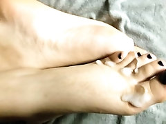 Pretty feet soaked in cum