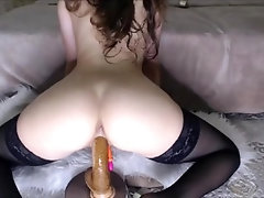 Amateur girl riding dildo