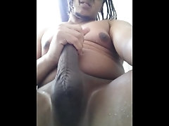 Wet black guy jacking off in the...